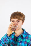 Boy drinking water. Out of a glass Stock Photography