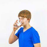 Boy drinking water. Out of a glass Royalty Free Stock Photo