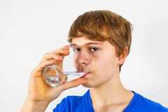 Boy drinking water. Out of a glass Royalty Free Stock Images