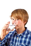 Boy drinking water out of a glass Royalty Free Stock Photography
