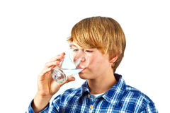 Boy drinking water out of a glass Stock Photography