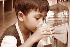 Boy drinking water vintage tone Royalty Free Stock Image
