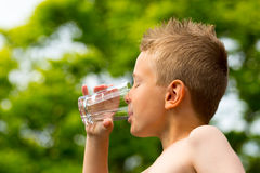 Boy drinking water Stock Image
