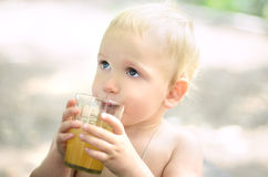 Boy drinks apple juice Stock Image