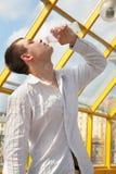 Boy drinks from bottle Stock Photo