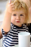 Boy drinks cup of milk Stock Photo