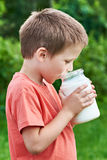 Boy drinks fresh milk Royalty Free Stock Photos
