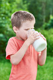 Boy drinks fresh milk Stock Images