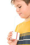 Boy drinks from gift through tubule. On white background Stock Photography
