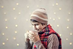 Boy drinks hot chocolate from a cup. Schoolboy drinks hot chocolate from a cup Royalty Free Stock Image