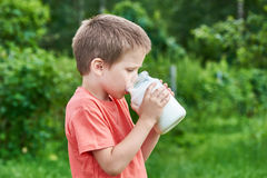 Boy drinks milk Stock Photo