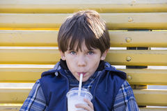 Boy drinks milkshake Stock Photography