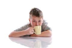 Boy drinks tea Stock Photo