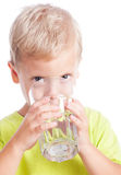 The boy drinks water from a glass Stock Photos