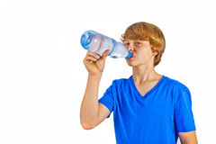 Boy drinks water out of a bottle Stock Photo