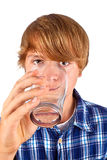 Boy drinks water out of a glass Stock Photos