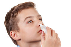 Boy drips medical nose drops Stock Photography