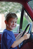 Boy Driver. Boy pretending to drive a truck Royalty Free Stock Images