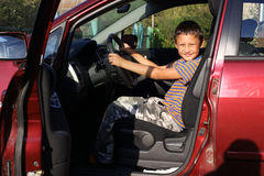Boy driver in car Royalty Free Stock Image