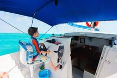 Boy drives catamaran Royalty Free Stock Images