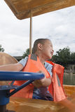 Boy driving boat Royalty Free Stock Photo