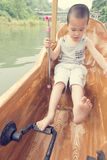 Boy driving boat Royalty Free Stock Photos