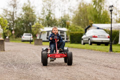 Boy driving on buggy cart Royalty Free Stock Photography