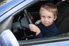 Boy driving a car Royalty Free Stock Images