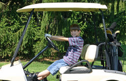 Boy Driving Cart Royalty Free Stock Photo