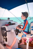 Boy driving catamaran Stock Photo