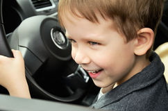 Boy driving horizontal closeup Stock Images