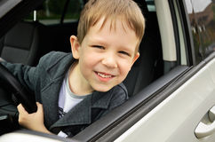 Boy driving horizontal Stock Image
