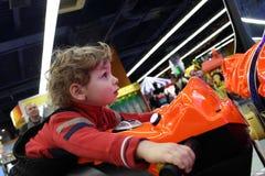 Boy driving motorbike toy Royalty Free Stock Image