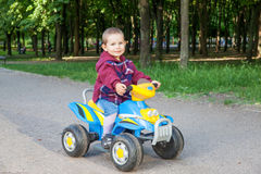 Boy driving the quad Stock Images