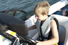 Boy Driving Ski Boat royalty free stock photos