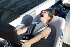 Boy Driving Ski Boat Fast Royalty Free Stock Images