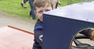 Boy driving a small steam engine at shanes castle may day steam rally estate antrim northern ireland stock video footage