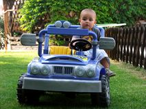Boy driving a toy car Royalty Free Stock Photos