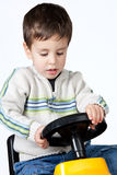 Boy driving a toy car. Isolated on white background Stock Images