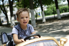 Boy driving a toy car Stock Photo