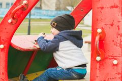 Boy driving a toy car on the Playground. Boy 3 years old sitting in a toy car on the Playground Stock Photography