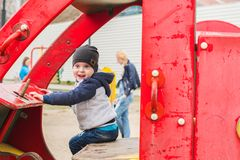 Boy driving a toy car on the Playground. Boy 3 years old sitting in a toy car on the Playground Royalty Free Stock Photography