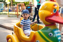 Boy driving toy duck Royalty Free Stock Photography