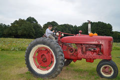 Boy driving tractor Stock Images