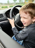Boy driving vertical closeup Stock Photos