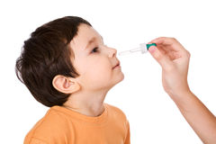 Boy drops in a nose drip Royalty Free Stock Images