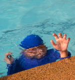 A boy drowning in the pool. A boy drowning in the pool, swimming cramps Royalty Free Stock Images