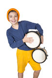 Boy with a drum. A young boy playing the drum royalty free stock photos