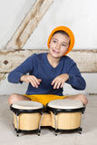 Boy with a drum. A young boy playing the drum royalty free stock image