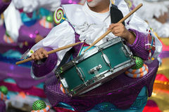 Boy drumming at carnival. Dressed in costume Stock Photos